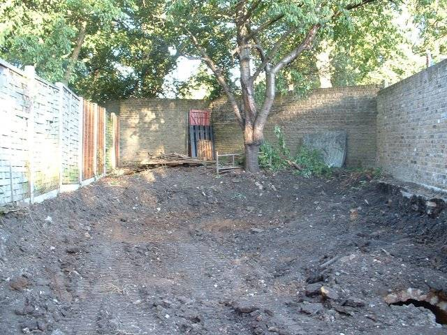 lowering the site to help the 'bed in garden' feel, to expose the sewer and to give us headroom.