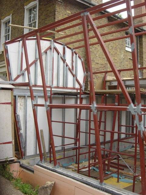 cladding goes on to the structure to both seal and make rigid.