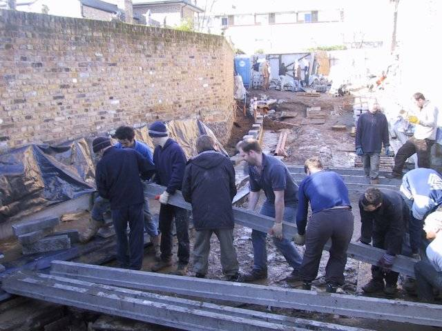 some of the smaller beams going in with just a few of the many friends prepared to help.