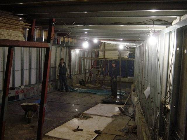 chris and abdul inside the main space as structure is largely finished.