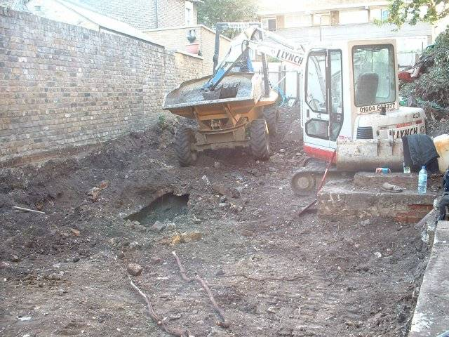 200 tons of soil later i could certainly dig, but still to clear old sewer and re-route the illegal one previously completely hidden.