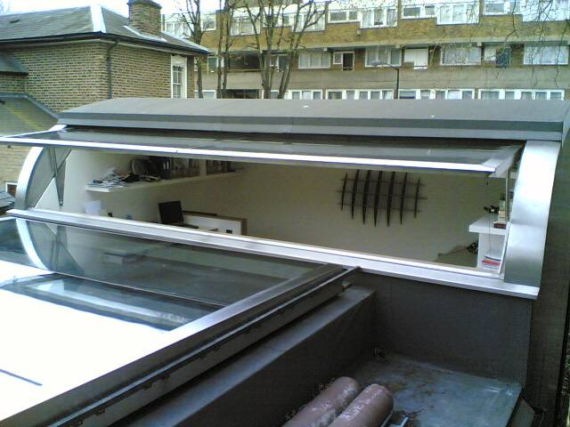 front mezzanine pod room window open and looking back into park over sliding rooflight.