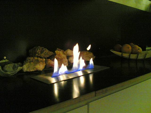 the blade flame fireplace giving the illusion of a fire in the wooden surface.
