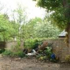 lowering the site to help the 'bed in garden' feel, to expose the sewer and to give us headroom