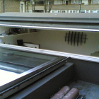 front mezzanine pod room window open and looking back into park over sliding roof light